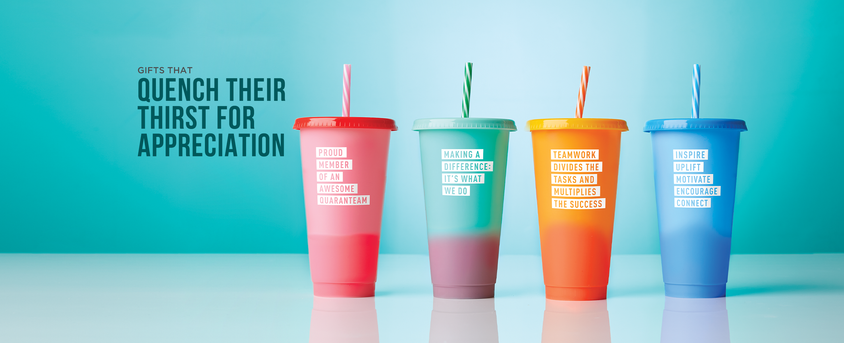 four tumblers with lids and straws in different colors